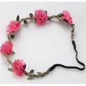 Bohemian style gevlochten haarbandje met blaadjes en roze bloemetjes