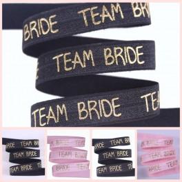 Elastische armband zwart of licht roze met gouden opdruk Team Bride