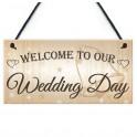 Houten bord aan touw met de tekst Welcome to our Wedding