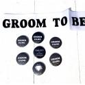 Set met 1 sjerp wit Groom to Be zwart en 7 buttons